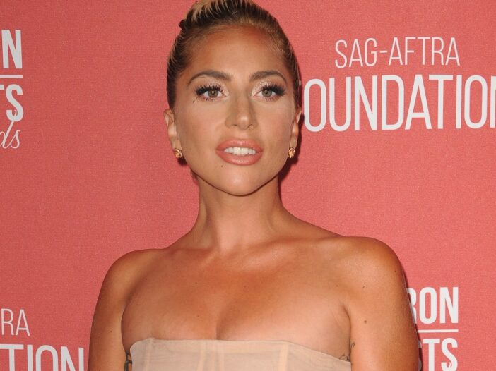 Lady Gaga wears a beige strapless dress to a SAG event