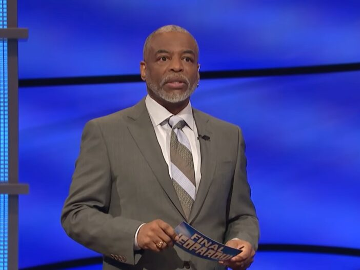LeVar Burton hosts Jeopardy! against a blue background on the iconic set