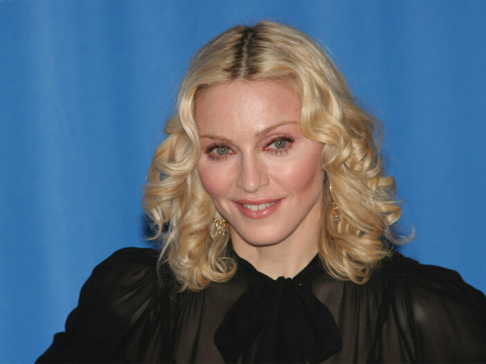 Madonna smiling in a black outfit