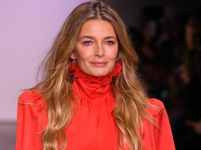 Paulina Poriszkova in red, walking on a runway.