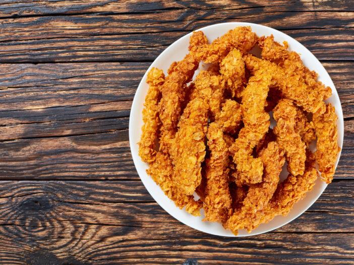 Plate of crispy chicken strips.