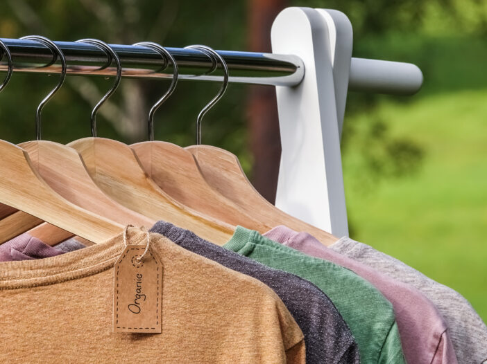 Image of clothes hung up on a rack outside.