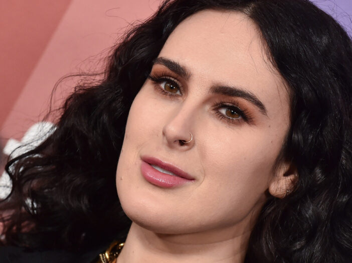 (DFree/Shutterstock.com) Rumer Willis wears a black top and chain necklace