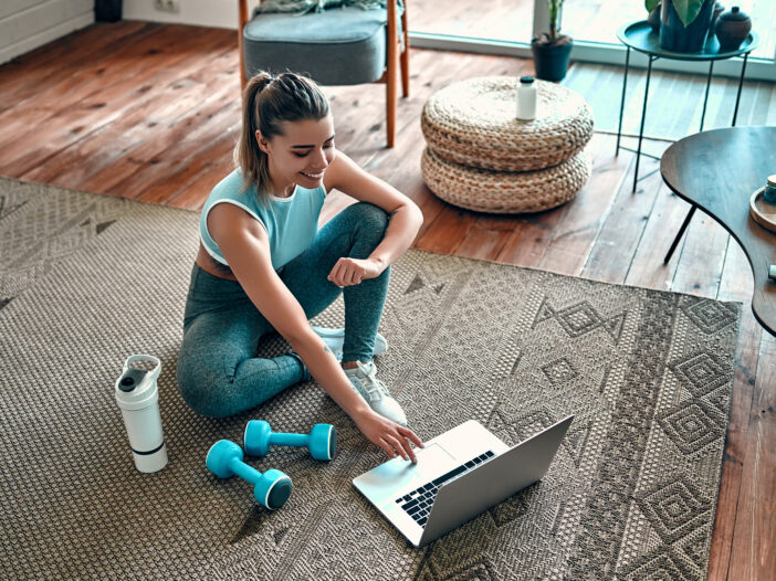 Image of a woman doing online workout videos.