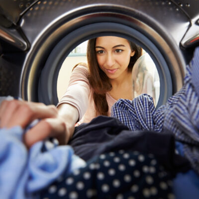 Image of woman washing clothes.
