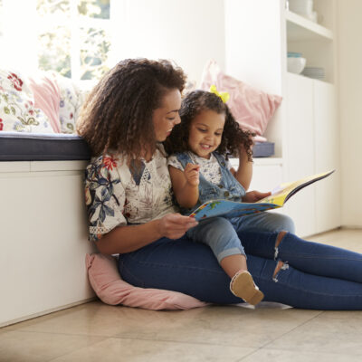 Image of mom reading to her child.