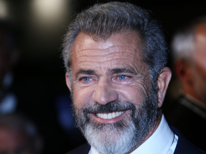 (Denis Makarenko/Shutterstock.com) Mel Gibson smiles in a suit and tie