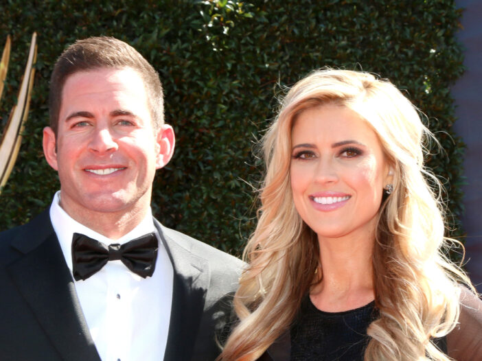 Ant Anstead and Christina Haack pose together, both dressed in black formalwear, on the red carpet