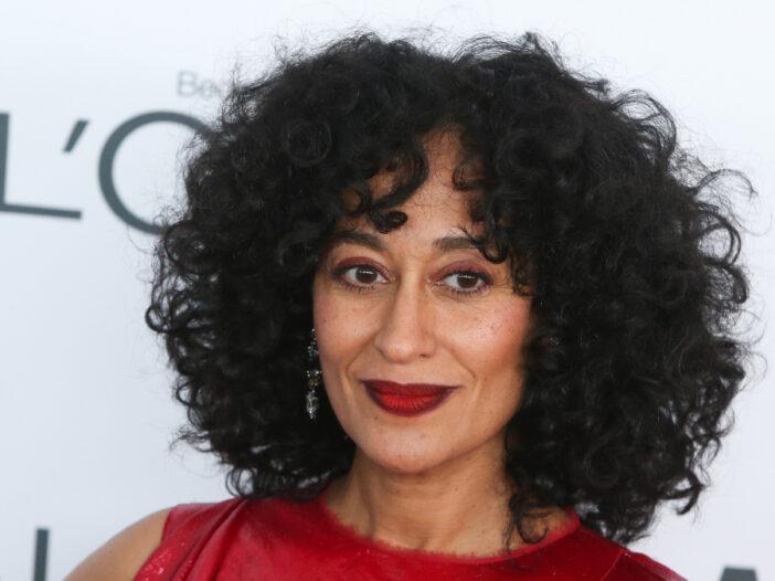 (a katz/Shutterstock.com) Tracee Ellis Ross wearing red dress