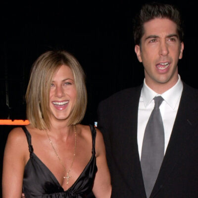 Jennifer Aniston in a black dress with David Schwimmer in a suit in 2001