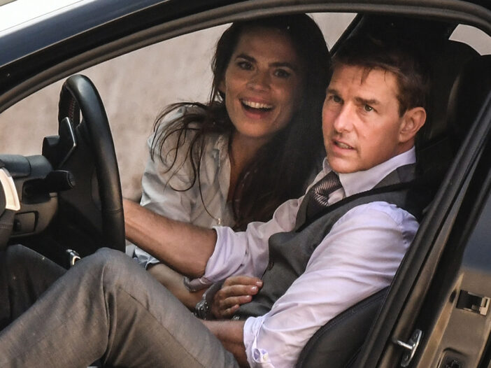 Haley Atwell and Tom Cruise in a car on the set of Mission Impossible 7