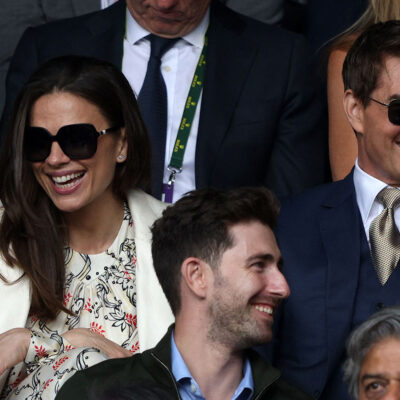 Tom Cruise in sunglasses on the right, Hayley Atwell in sunglasses on the left.