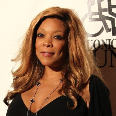 Wendy Williams wears a black dress on the red carpet