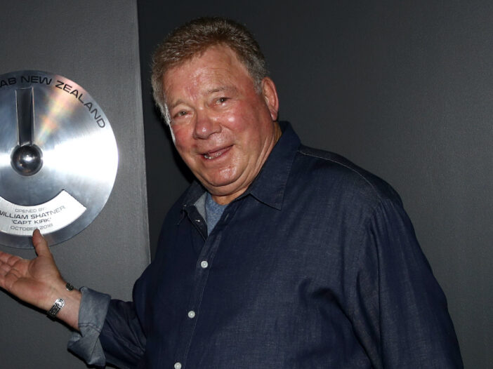 William Shatner in a blue button up shirt