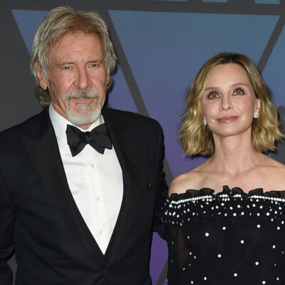 Harrison Ford in a tuxedo with Calista Flockhart in a white and black dress