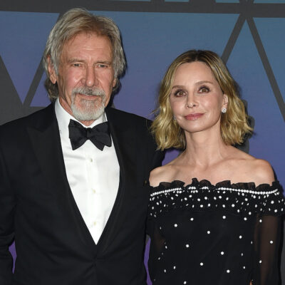 Harrison Ford in a tuxedo with wife Calista Flockhart in a black dress