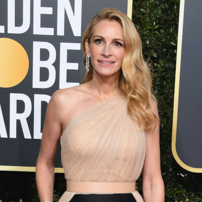 Julia Roberts at the Golden Globes in a tan and black outfit
