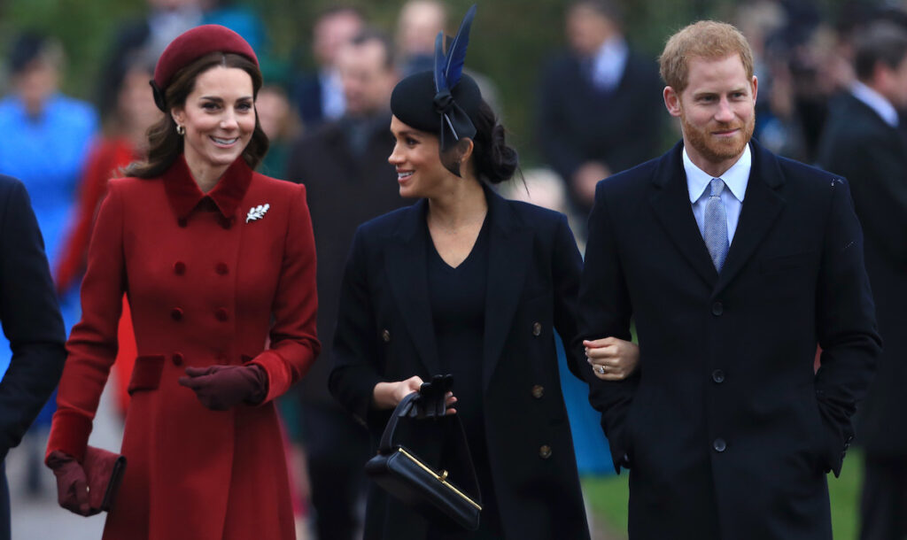 Kate Middleton, Meghan Markle, and Prince Harry walk together outside