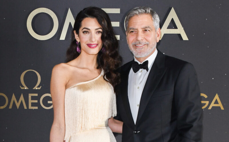 Amal Clooney in a white dress with George Clooney in a tux