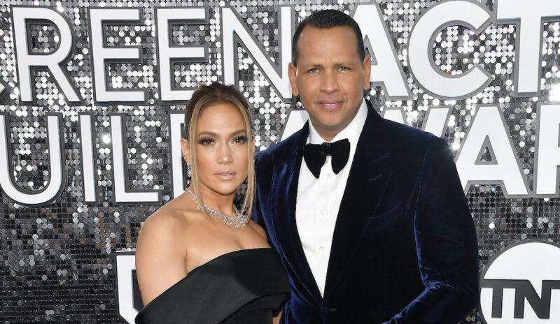 Jennifer Lopez in a black dress with Alex Rodriguez in a tux