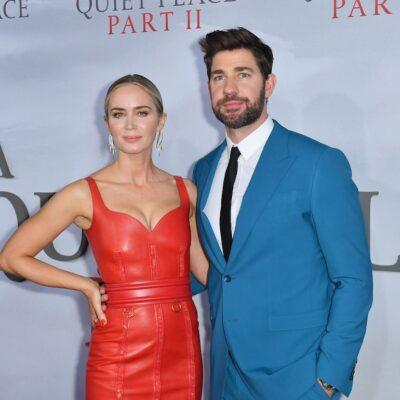 John Krasinski in a blue suit with Emily Blunt in a red dress