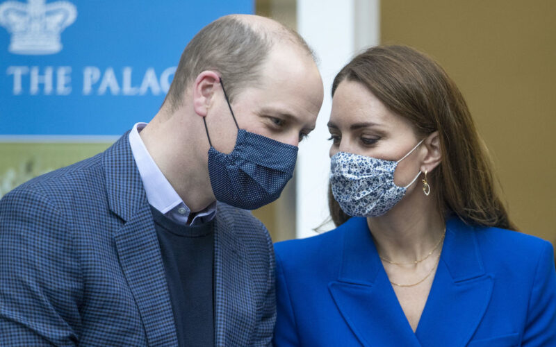 Prince William in a blue suit with Kate Middleton in a blue outfit