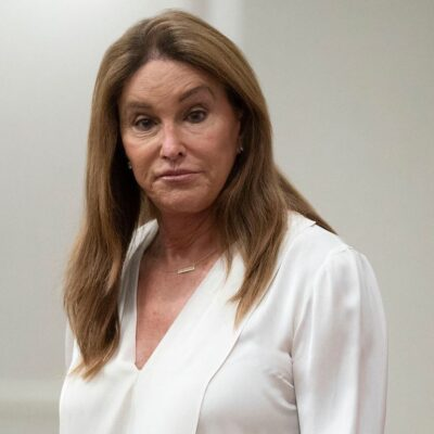 Caitlyn Jenner in a white blouse at a press conference