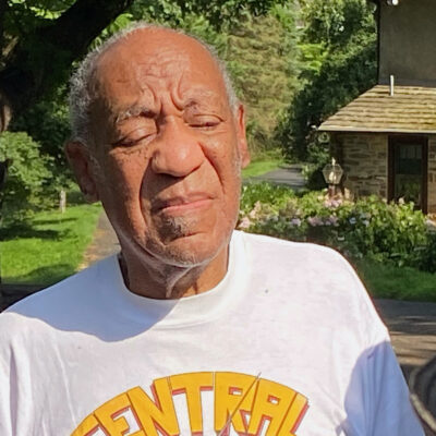Bill Cosby in a white t-shirt outdoors