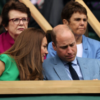 Kate Middleton leans in to talk to Prince William at Wimbledon