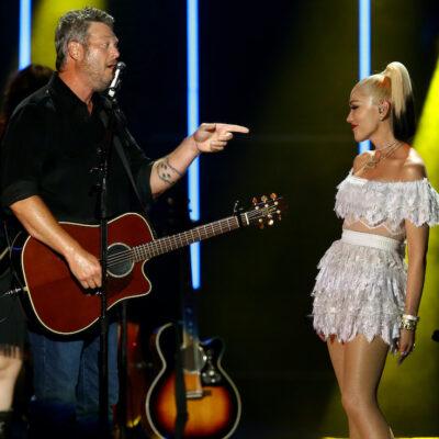 Blake Shelton pointing at Gwen Stefani on stage at CMA Summer Jam