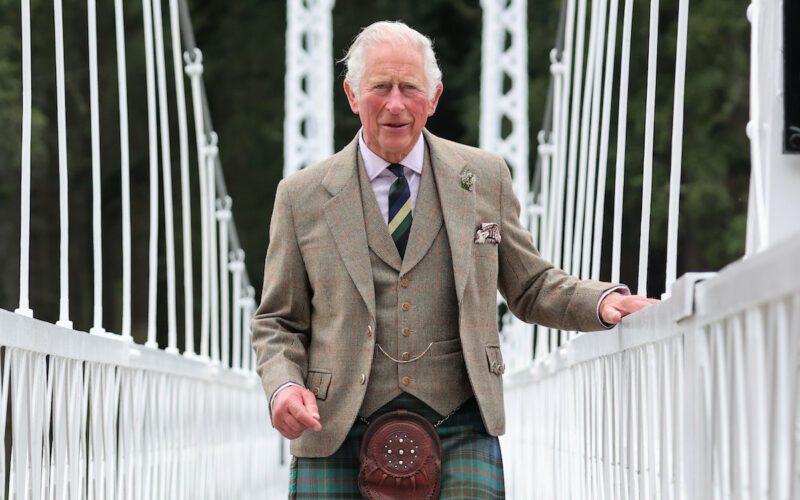 Prince Charles in a brown coat and green kilt