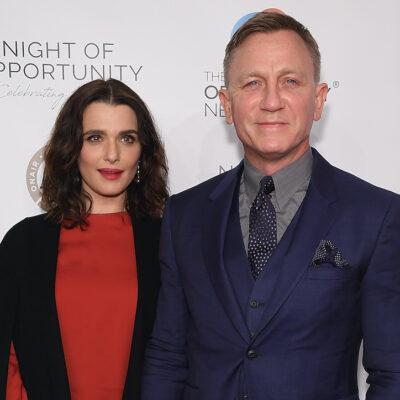 Daniel Craig in a blue suit with Rachel Weisz in a red dress