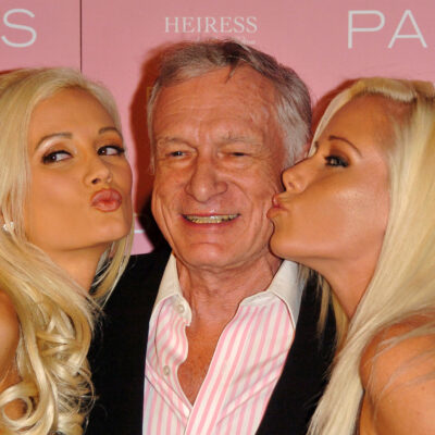 Left to right: Holly Madison, Hugh Hefner, and Kendra Wilkinson at the launch of Paris Hilton's debut CD 'Paris'