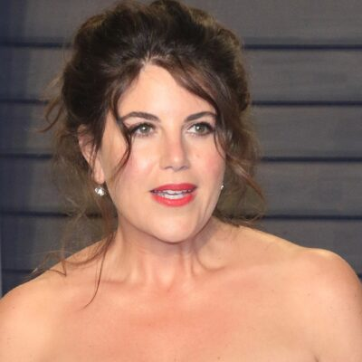 Monica Lewinsky wears a strapless dark dress on the red carpet