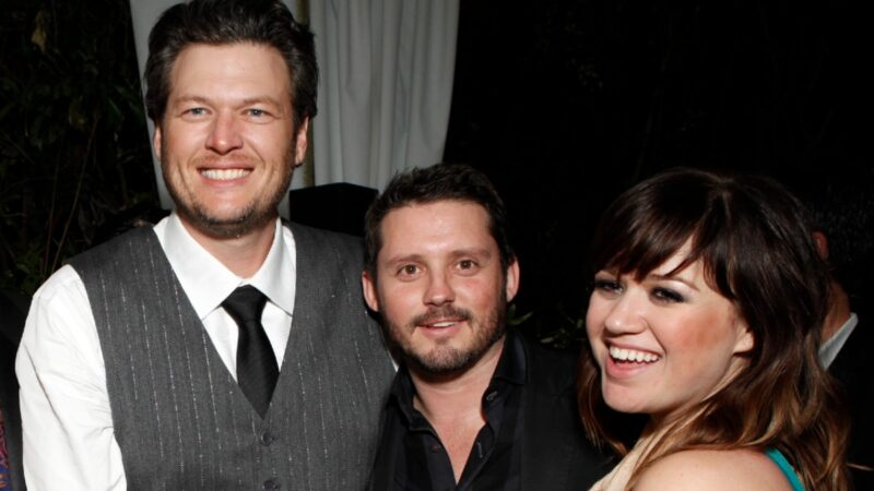 Blake Shelton, Brandon Blackstock, and Kelly Clarkson pose together for a photo