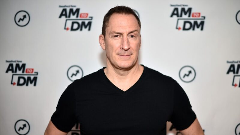 Ben Bailey wears a black t shirt on the red carpet