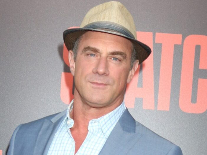 Christopher Meloni wears a gray suit and a hat to a movie premiere
