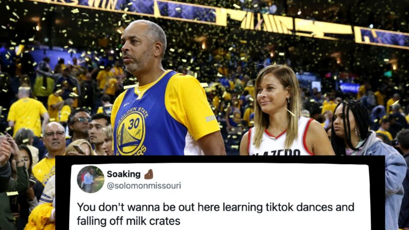 Dell Curry, in a Golden State Warriors jersey, and Sonya Curry, in a Blazers jersey, walk past the court