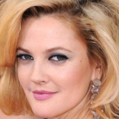 Drew Barrymore shoots a sultry look over her shoulder on the red carpet