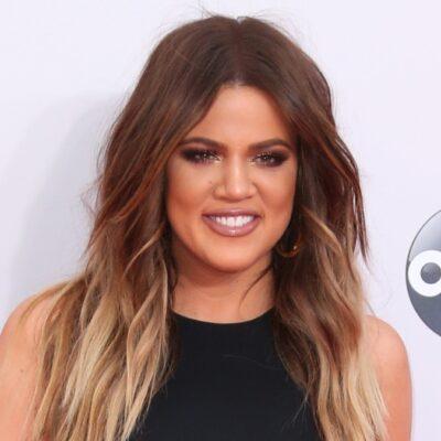 Khloe Kardashian wears a black dress on the red carpet