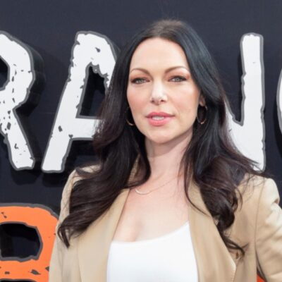 Laura Prepon wears a tan suit on the red carpet