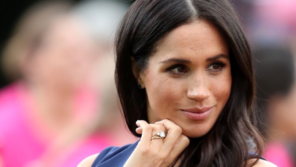 Meghan Markle wears a blue dress at an outdoor royal event