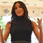 Meghan Markle wears a sleeveless black turtleneck as she makes remarks before a crowd