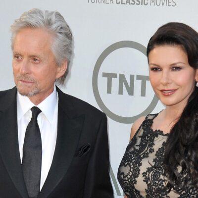 Michael Douglas, in a black suit, and Catherine Zeta-Jones, in a black dress, walk the red carpet