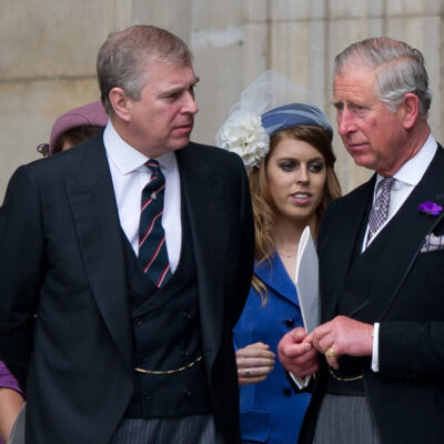 Prince Andrew on the left, speaking with Prince Charles on the right