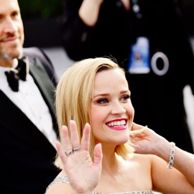 Jim Toth walks with wife Reese witherspoon on the red carpet