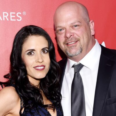 Rick Harrison, in a black suit, poses with now ex-wife Deanna, in a blue gown