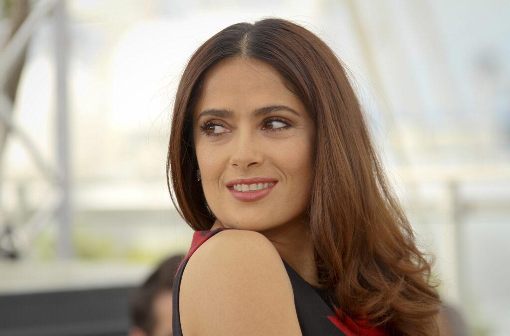Salma Hayek looking back over her left shoulder