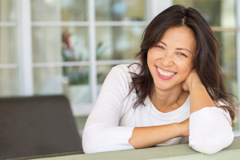 Image of mature woman smiling.