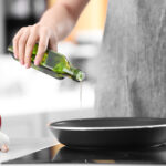 Image of woman cooking with olive oil.